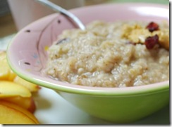 A bowl of oats with banana, dried cranberries and peanut butter